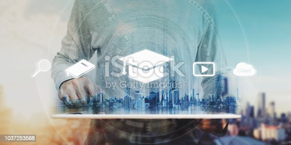 istock Online education, e-learning and e-book concept. a man using digital tablet for education, with education and online learning media icons 1037253568