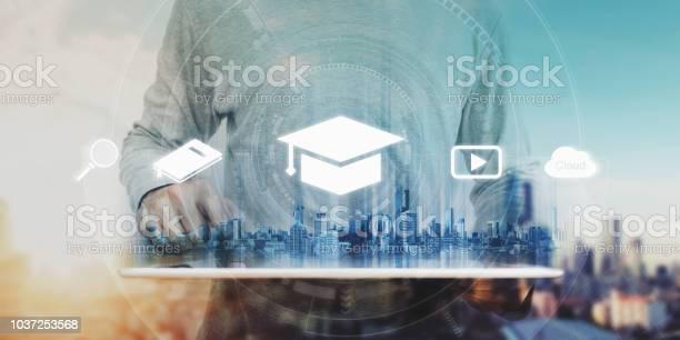 Online education elearning and ebook concept a man using digital for picture id1037253568?b=1&k=6&m=1037253568&s=612x612&h=nj9n2fhkcvsuuyuny2t3jzlocbdzukhbz6iwjijwubu=