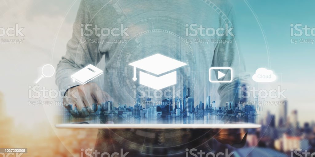 Online education, e-learning and e-book concept. a man using digital tablet for education, with education and online learning media icons stock photo
