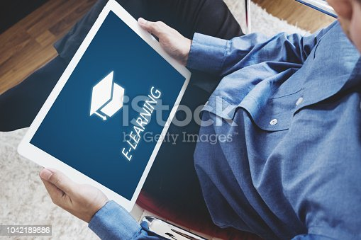 istock Online education, e-learning and e-book concept. a man using digital tablet for education at home 1042189886