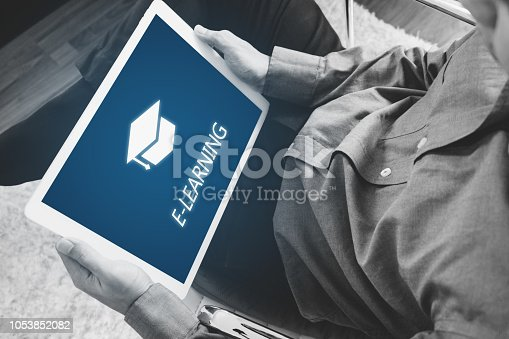istock Online education, e-learning and e-book concept. a man using digital tablet for education 1053852082