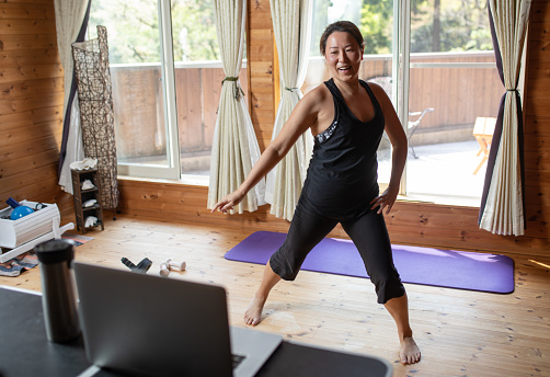 One woman exercising while staying at home.