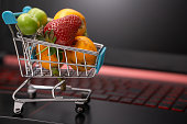 istock online food and fruit shopping from home with computer 1224885759