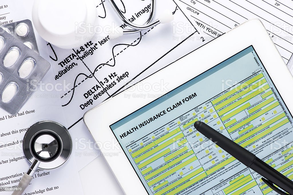 Online insurance claim form with stethoscope stock photo