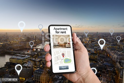 1023041738 istock photo Online internet search apartment for rent mobile phone app holiday home rental city aerial view 1127381924