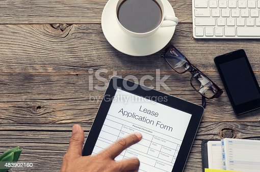 istock Online lease application form with pointing finger. 483902160