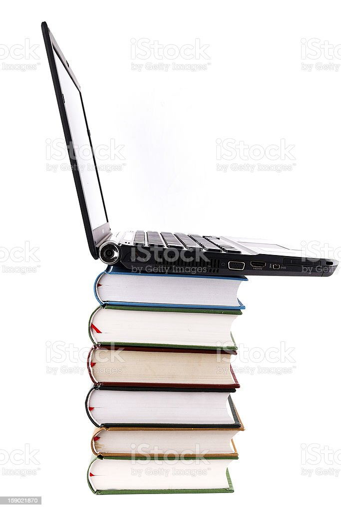 online library:laptop and books royalty-free stock photo