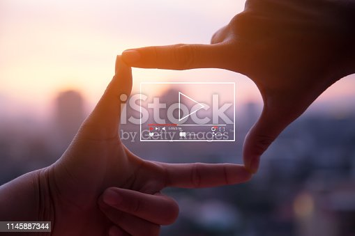 Photo sign made by human hands on blurred sunset sky as background