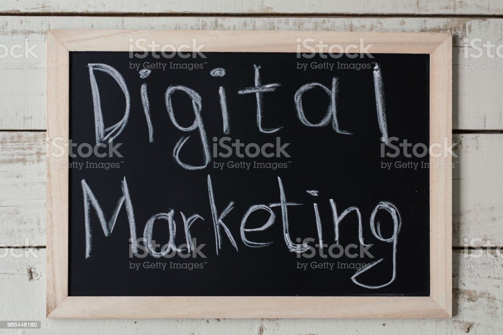 """Online marketing concept. Blackboard with text """"Digital Marketing"""" on wooden background royalty-free stock photo"""