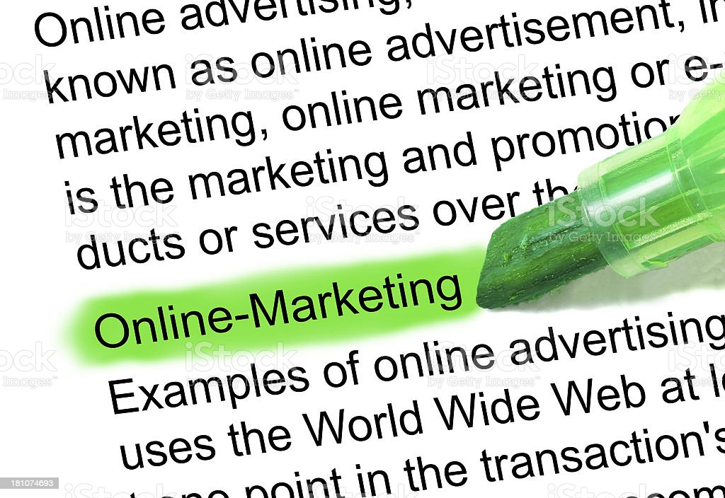Online Marketing definition highlighted in dictionary stock photo