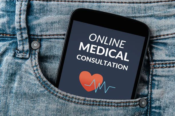 Online medical consultation concept on smartphone screen in jeans pocket stock photo