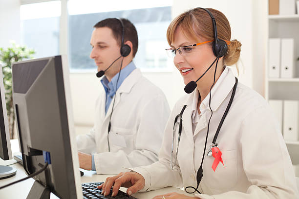 online medicine support. - nurse on phone stock photos and pictures
