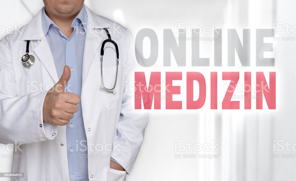 Online Medizin (in german online medicine) concept and doctor with thumbs up stock photo