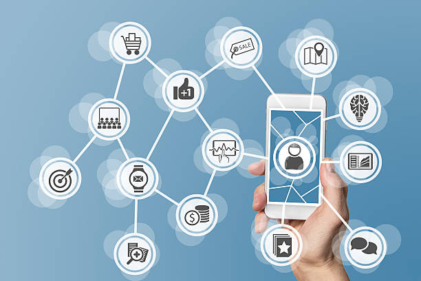 Online mobile marketing concept with hand holding smart phone stock photo