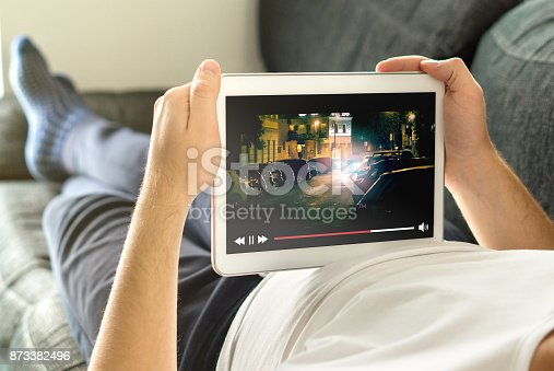 istock Online movie stream with mobile device. 873382496