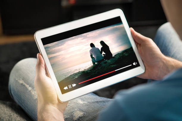 online movie stream with mobile device. - tablet stock photos and pictures