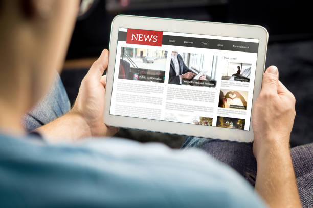 online news article on tablet screen. electronic newspaper or magazine. latest daily press and media. mockup of digital portal and website. happy person using web service in the morning. - news imagens e fotografias de stock