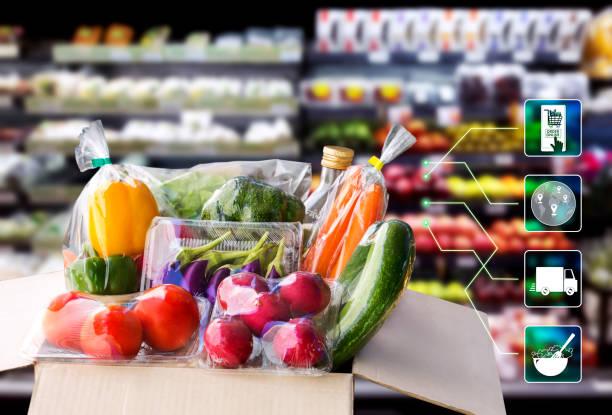 온라인 주문 식료품 쇼핑 개념입니다. 음식 배달 재료 도시에서 라이프 스타일 슈퍼마켓 배경에 패키지 상자와 아이콘 미디어와 요리에 대 한 가정에서 서비스를 제공 합니다. 스톡 사진