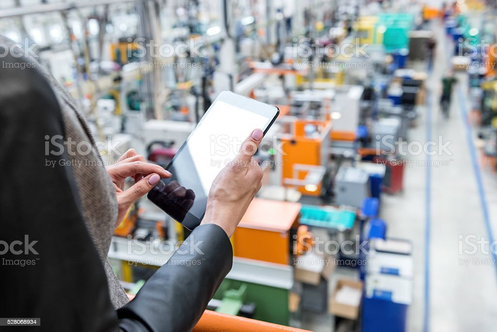 On-line orders in futuristic factory stock photo