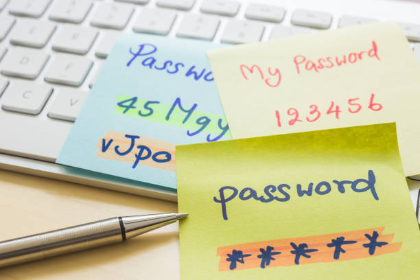 online password management with keyborard, notes, pen. - aggiornamento software foto e immagini stock