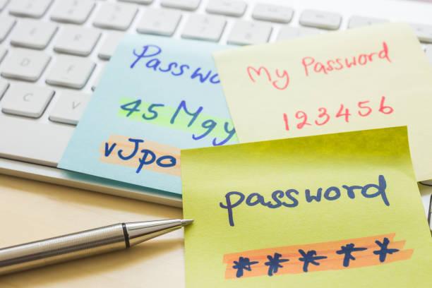 Online password management with keyborard, notes, pen. stock photo