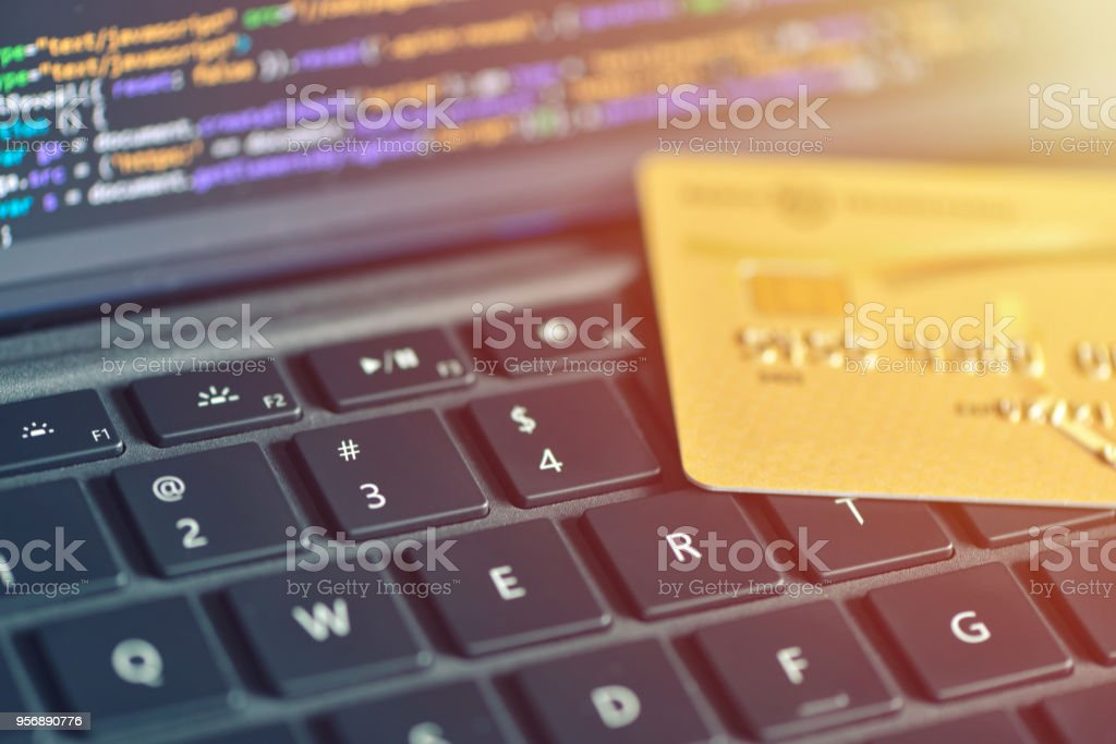 Online Payment Concept Credit Card On Laptop Keyboard Closeup Angle