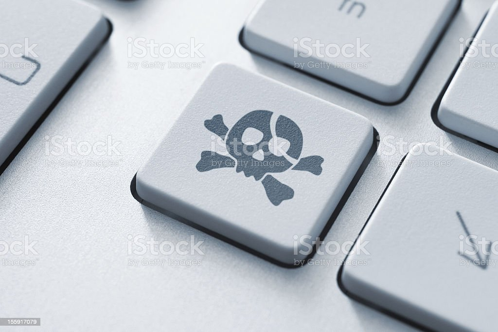 On-line Piracy Key stock photo