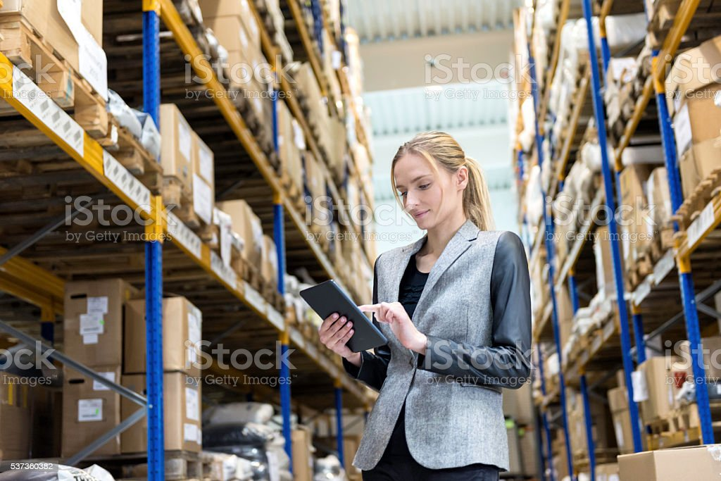 On-line processing orders from storage room stock photo
