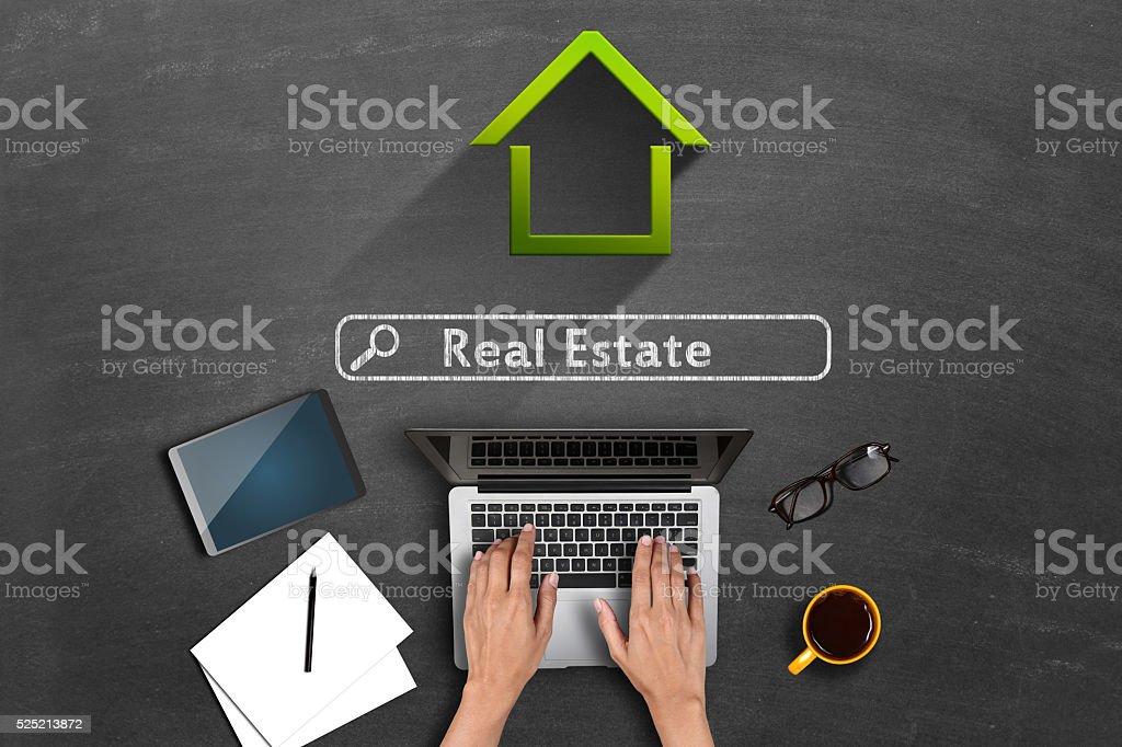 Online real estate concept on blackboard stock photo