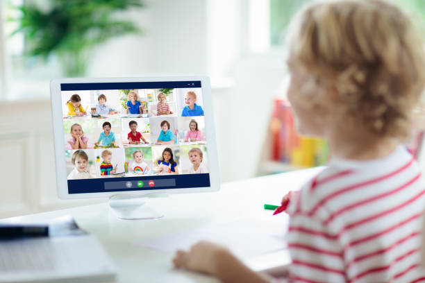 Online remote learning. School kids with computer. stock photo