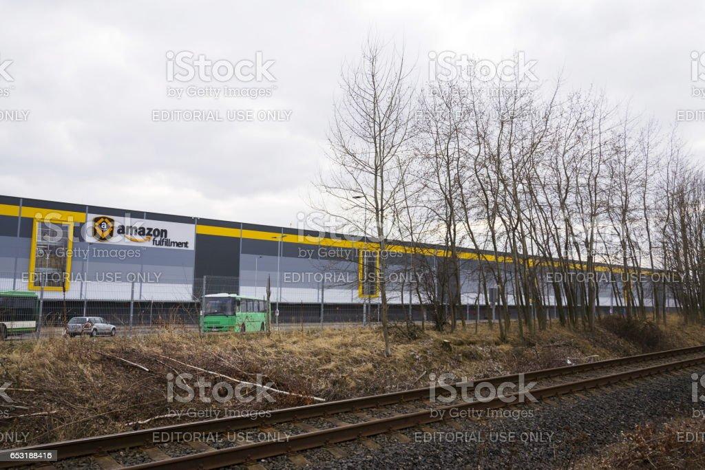 Online retailer company Amazon fulfillment logistics building stock photo