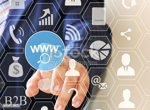 492960182 istock photo WWW online searches button  on the touch screen with a blur background of the businessman 953853600
