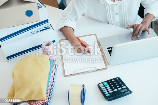 800488732 istock photo Online seller owner checking the customer orders. 1008345684