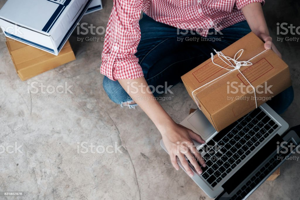 Online seller owner using computer for checking customer orders. stock photo