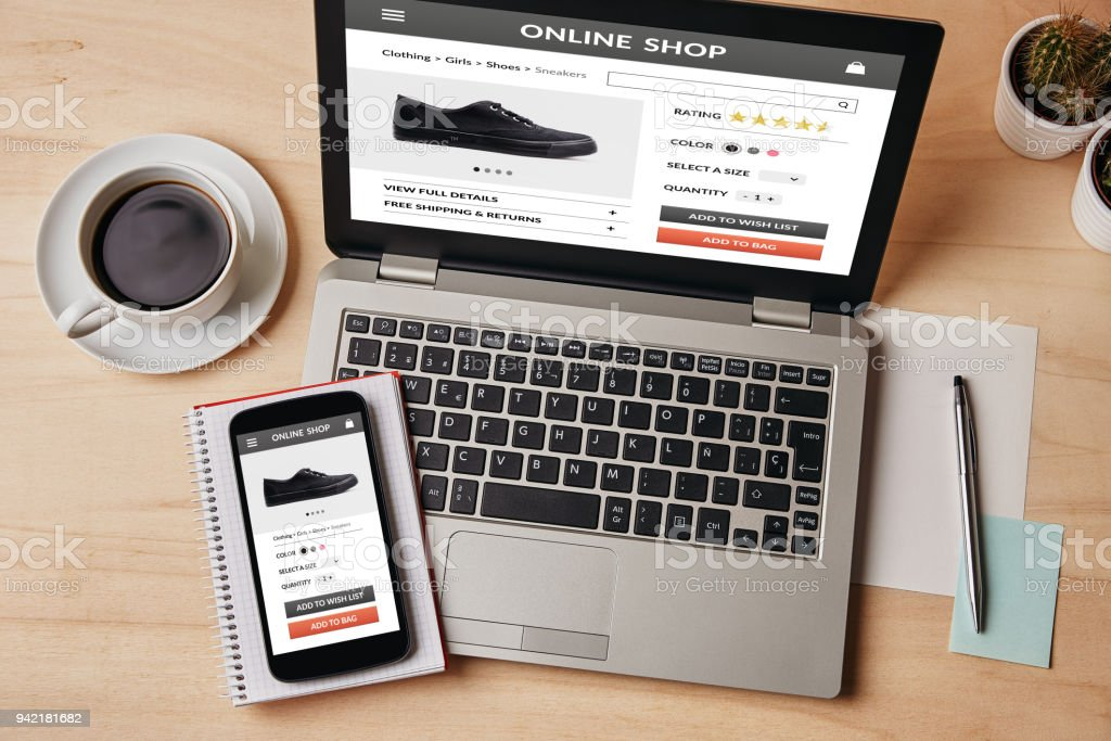 Online shop concept on laptop and smartphone screen stock photo