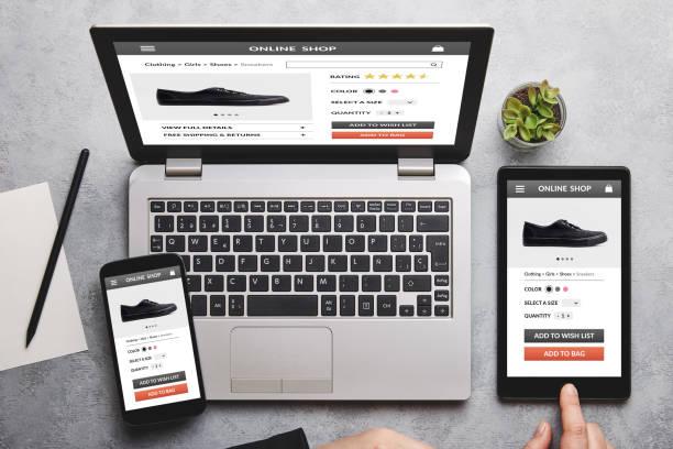 online shop concept on laptop, tablet and smartphone screen - commercio elettronico foto e immagini stock