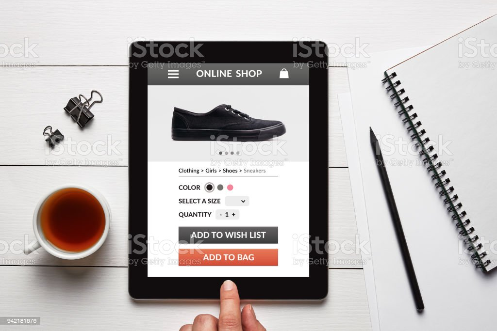 Online shop concept on tablet screen on white wooden table stock photo