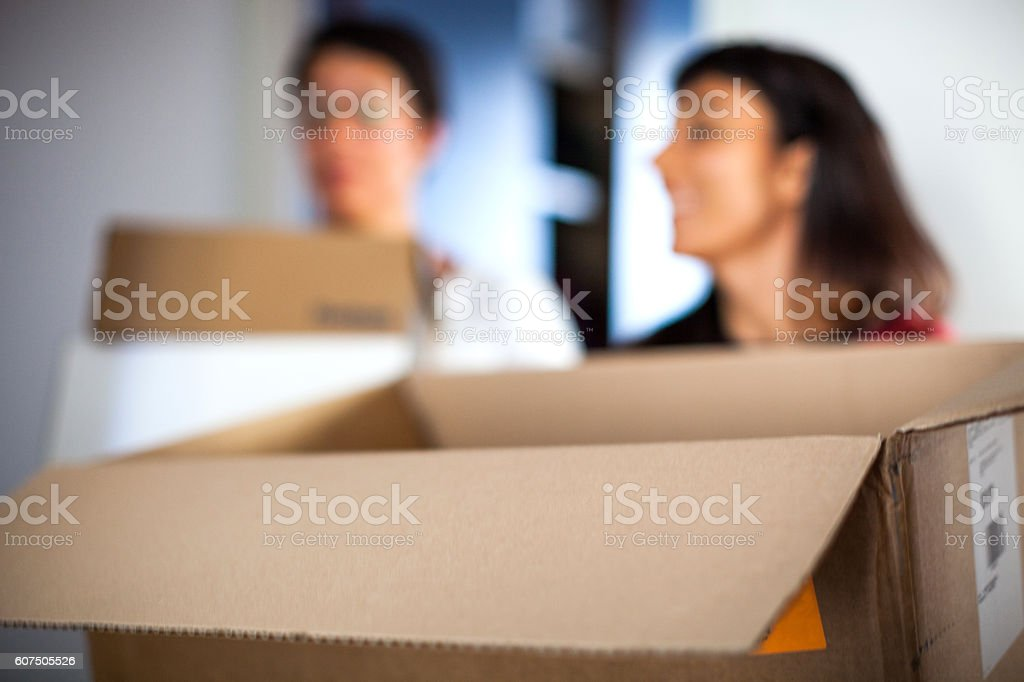 Online shopping at home - Women unboxing clothes stock photo