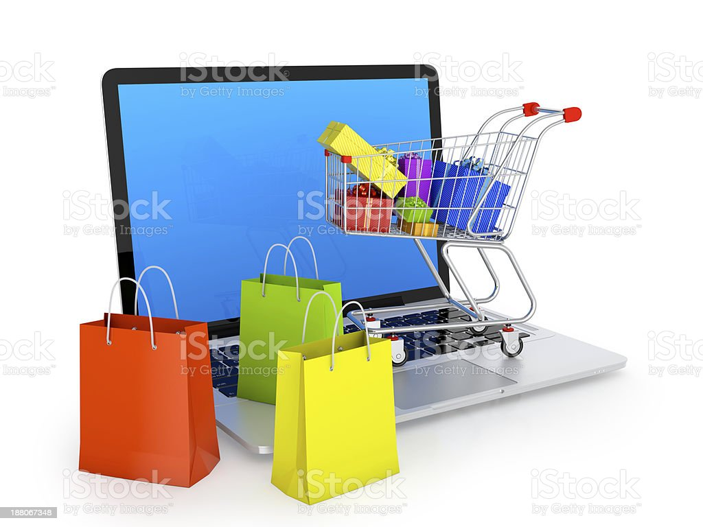 Online shopping cart and multicolor bags filled with gifts stock photo