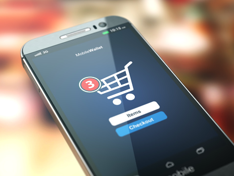Online Shopping Concept Mobile Phone Or Smartphone With Cart On Stock Photo - Download Image Now