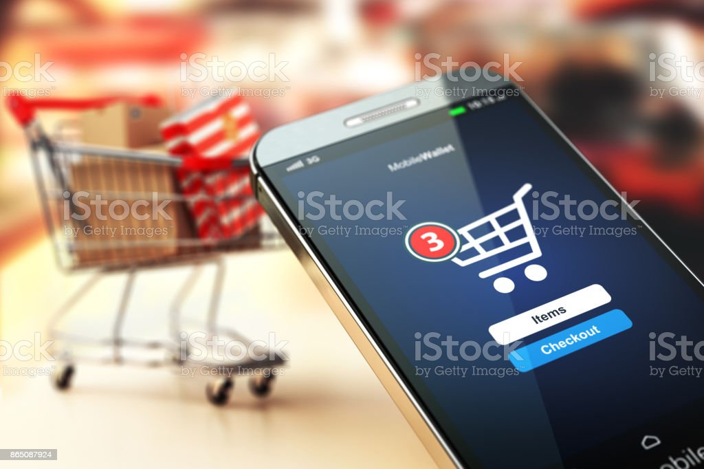 Online shopping concept nackground. Mobile phone or smartphone with cart and boxes and bag. stock photo