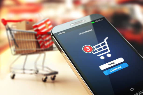 online shopping concept nackground. mobile phone or smartphone with cart and boxes and bag. - store counter stock photos and pictures