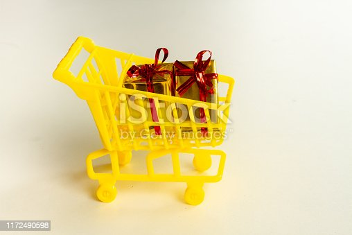 Online shopping concept - trolley cart full of presents. Black Friday and Ciber Mondey.