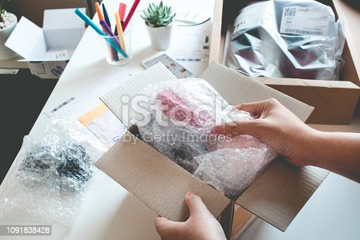 Online shopping concepts with female open box, presents some product in her hand.Ecommerce,shipping delivery service.Business retail market