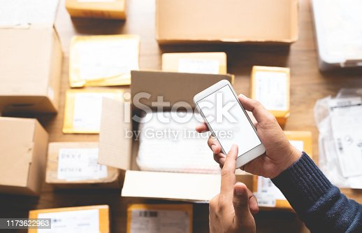 868776578 istock photo Online shopping concepts with youngman using smartphone on a lot of packag box.Ecommerce marke.Transportation logistic 1173622963