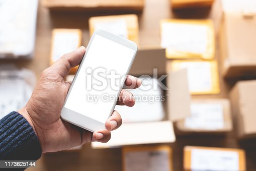 868776578 istock photo Online shopping concepts with youngman using smartphone on a lot of packag box.Ecommerce marke.Transportation logistic 1173625144