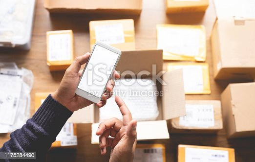 868776578 istock photo Online shopping concepts with youngman using smartphone on a lot of packag box.Ecommerce market.Transportation logistic 1175284490