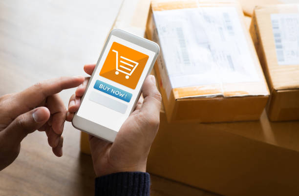 Online shopping concepts with youngman using smartphone on product package box.Ecommerce market.Transportation logistic.Business retail stock photo