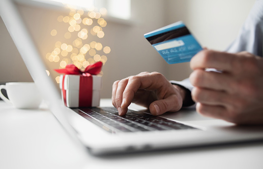 Ordering Christmas presents, online payment. Online shopping, internet banking, spending money, holidays, vacations concept