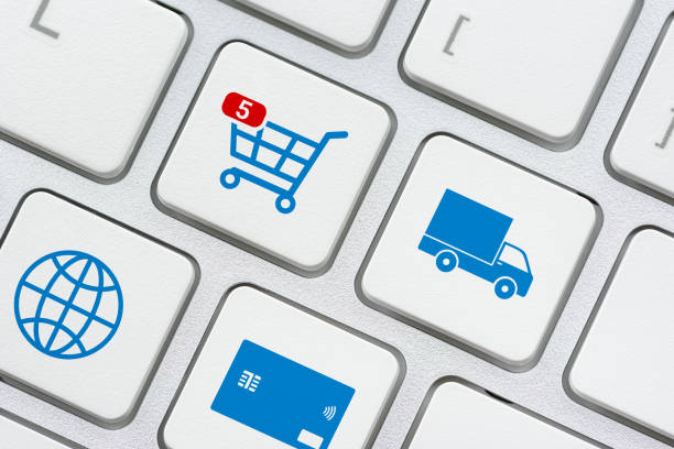 Online shopping / ecommerce and retail sale concept : Shopping cart, delivery van, credit card, world globe logo on a laptop keyboard, depicts customers order things from retailer sites using internet Online shopping / ecommerce and retail sale concept : Shopping cart, delivery van, credit card, world globe logo on a laptop keyboard, depicts customers order things from retailer sites using internet arrange stock pictures, royalty-free photos & images